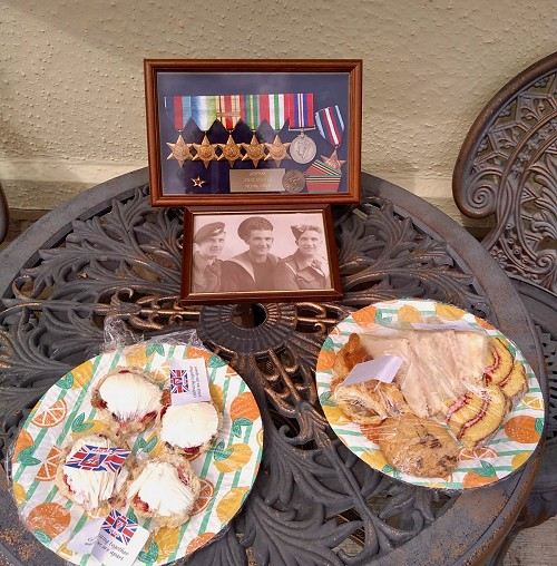 Two of the special teas alongside a grateful resident's war medals.