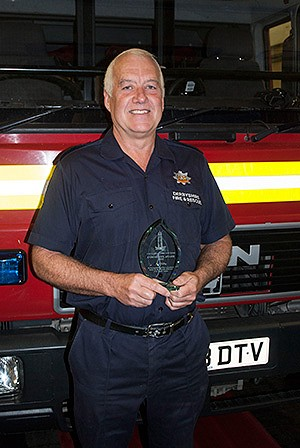 Phil Dolby with his award