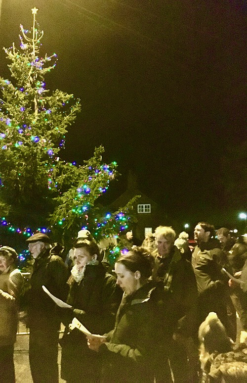 Crich Market Place tree with carol singers