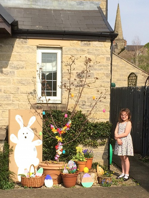 Girl standing outside her house with her Easter decorations