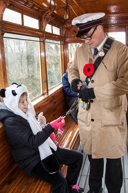 Girl and ticket inspector on a Tram